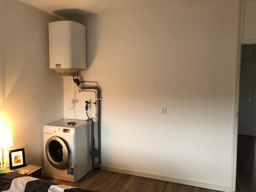 Wasmachine en CV ketel verbergen achter een kast