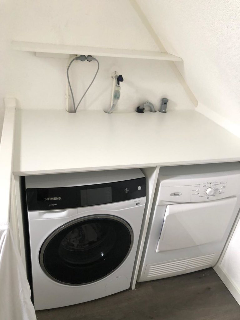 Werkblad over wasmachine en droger heen